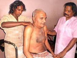 Lenish John with his Guru Sri. Jos Jacob treating a patient