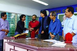 Lenish John receiving award from Indian philosopher and activist Rahul Easwar